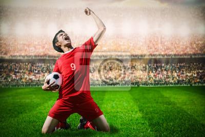 Stürmer Fußball Fußballspieler im roten Team Konzept feiern g