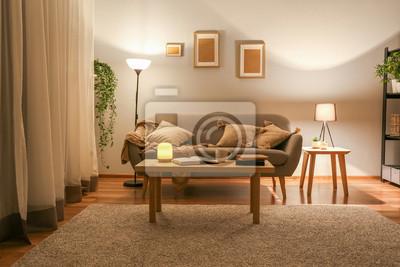 Bild Stylish interior of living room at night