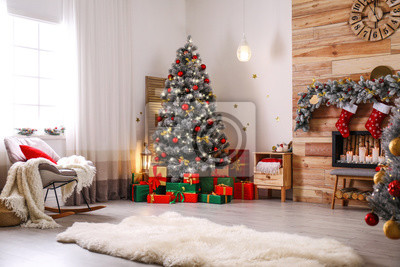 Bild Stylish room interior with beautiful Christmas tree and decorative fireplace