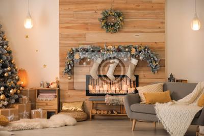 Bild Stylish room interior with beautiful Christmas tree and decorative fireplace