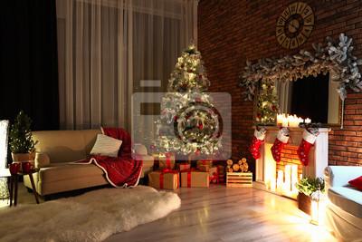 Bild Stylish room interior with beautiful Christmas tree in evening