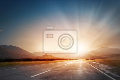 Bild Sunset above road