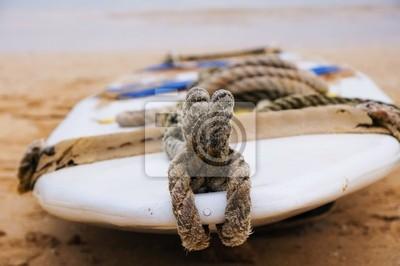 Surfbrett auf dem Sand