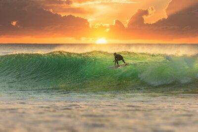 Bild Surfer Surfing at Sunrise