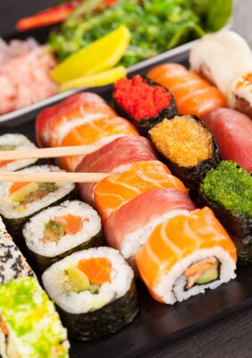 Bild sushi pieces with chopsticks