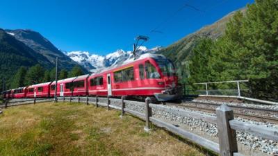Bild Swiss mountain train Bernina Express crossed Alps