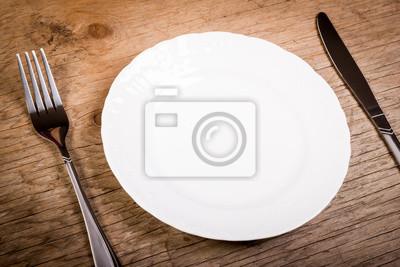 teller und besteck auf einem h lzernen alten tisch leinwandbilder bilder holztisch hunger. Black Bedroom Furniture Sets. Home Design Ideas