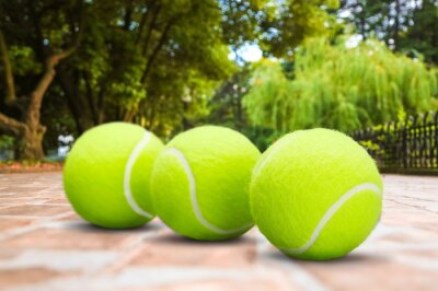 Tennis balls and rackets on a stone floor