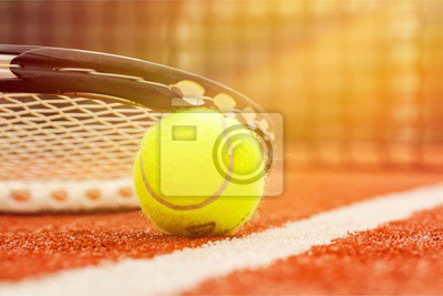 Tennis game. Tennis ball and racket on court background