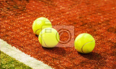 Tennis game. Tennis balls and rackets on  background.