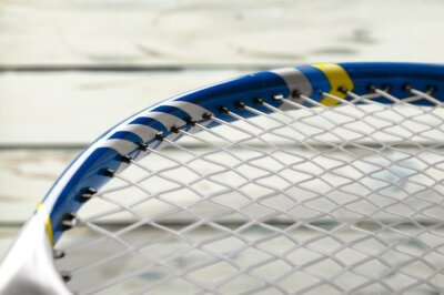 Tennis game. Tennis balls and rackets on desk.