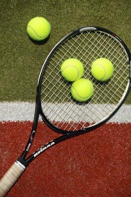 Tennis racket and tennis balls on a tennis court