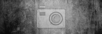 Bild Textur einer dunklen, alten Betonwand als Hintergrund, auf die nur etwas Licht fällt