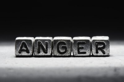 Bild The concept of anger, emotion management technique. Word on metal cubes isolated on black background.