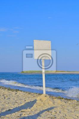 The empty signpost on the seashore