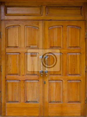 The wide wooden doors, the entrance to a public building