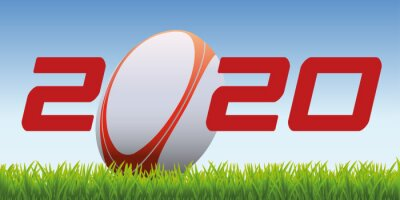The year 2020 symbolizes the world of rugby with an oval ball placed on the lawn of a field