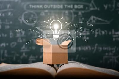 Bild think outside the box on school green blackboard . startup  education concept. creative idea. leadership.