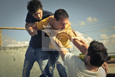 Bild Three young guys in a fight