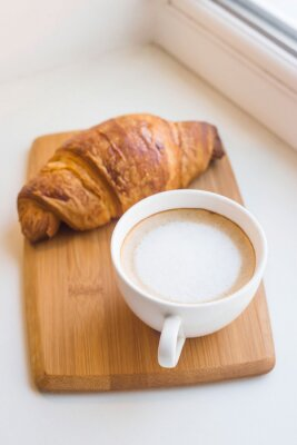 Bild Traditional French breakfast of coffee and fresh croissant