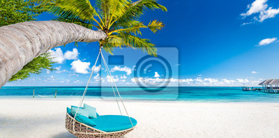 Bild Tropical beach background as summer landscape with beach swing or hammock and white sand and calm sea for beach banner. Perfect beach scene vacation and summer holiday concept. Boost up color process