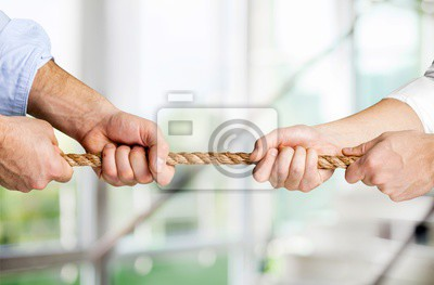 Bild Tug war, two businessman pulling a rope in opposite directions isolated on white background