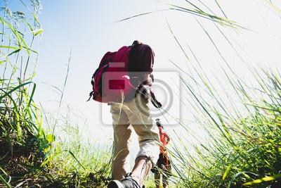Bild Two asia female walking by hiking trail .