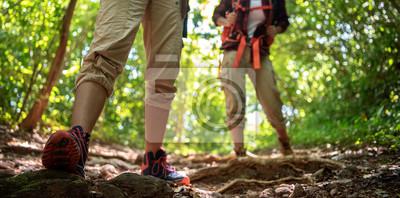 Bild Two asian female walking by hiking trail .