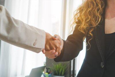 Bild Two business people doing handshake after deal negotiation complete.