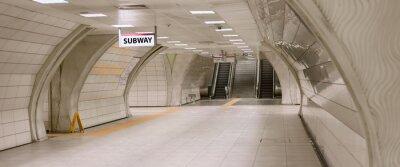 Bild Underground subway station hallway tunnel with escalator. Abstract perspective view