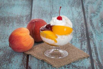 Bild Vanilla peach melba ice cream with peach fruits on wooden vintag