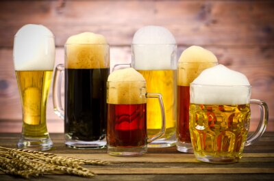 Bild Variety of beer glasses on a wooden table
