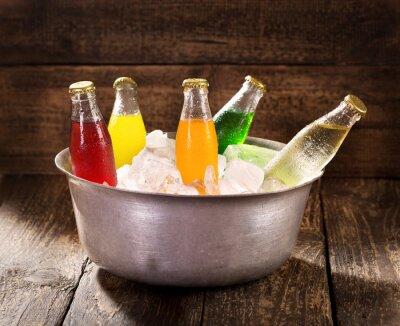 Bild various bottles of soda in the bucket with ice