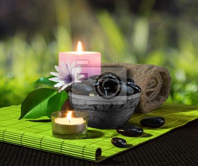 vaso di Pietre nere e su candele stuoia verde