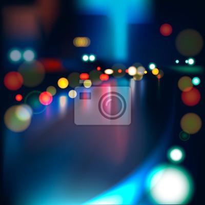 Verschwommene defokussiert Lichter auf Rainy City Road bei Nacht