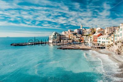 Bild View of Bogliasco. Bogliasco is a ancient fishing village in Italy, Genoa, Liguria. Mediterranean Sea, sandy beach and architecture of Bogliasco town. Cloudy blue sky sunny day idyllic scenery, winter