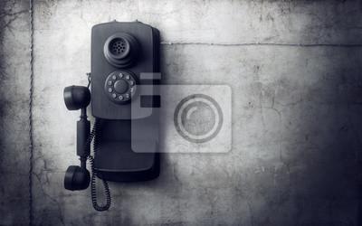 Bild Vintage phone auf Betonwand