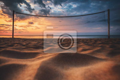 Volleyball net and sunrise on the beach