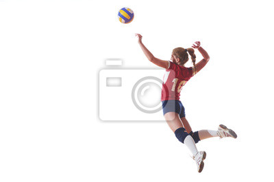 Bild volleyball woman jump and kick ball isolated on white background