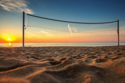 Bild Volleyballnetz und Sonnenaufgang am Strand