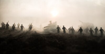 Bild War Concept. Military silhouettes fighting scene on war fog sky background, World War Soldiers Silhouettes Below Cloudy Skyline at sunset. Attack scene. Armored vehicles.