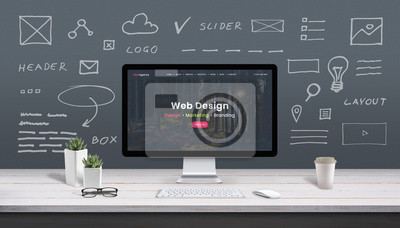 Bild Web design concept with computer display, web theme and drawings of website, app parts. Modern design web page on computer display. Office, studio work desk.