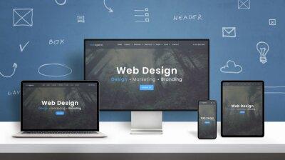 Bild Web design studio web site responsive design presentation on computer display, laptop, smart phone and tablet. Blue wall with web design concept elements