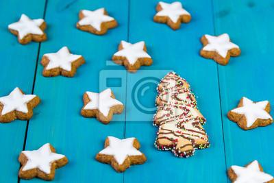 Glasur Weihnachtsplätzchen.Bild Weihnachtsplätzchen Auf Einem Blauen Hölzernen Hintergrund Zimtsterne