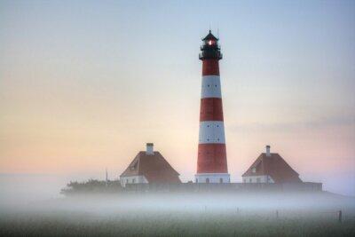 Bild Westerhever Leuchtturm im Nebel Sonnenaufgang
