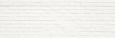 Bild White brick wall background. Neutral texture of a flat brick wall close-up.