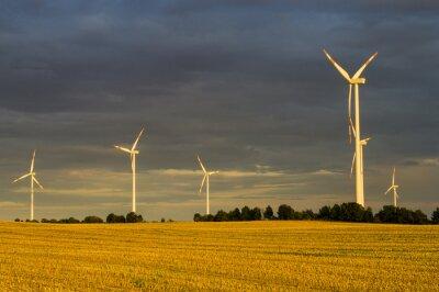 Bild Wiatraki(turbiny wiatrowe) w świetle wschodzącego słońca