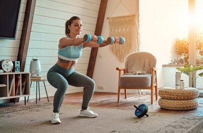 Bild Woman doing exercises at home.