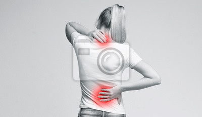 Bild Woman rubbing her painful neck and back