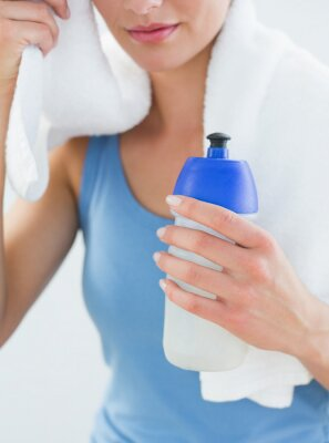 Woman with towel around neck and waterbottle